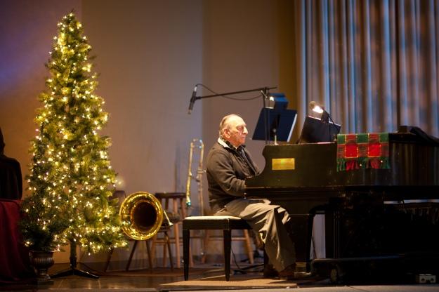 Our own Dave K plays faithfully on the Christmas songs