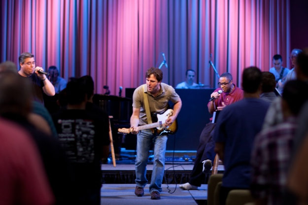 Tom leads over 200 men in worship at this discipleship event, with a great team of guys